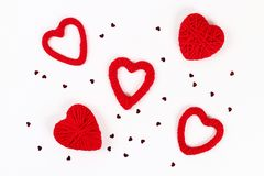 Valentine day layout. Red homemade diy hearts made of cardboard and yarn on a white background. Idea St. Valentines Day, day love. February 14 concept. Copy stock photography