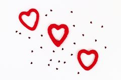 Valentine day layout. Red homemade diy hearts made of cardboard and yarn on a white background. Idea St. Valentines Day, day love. February 14 concept. Copy stock photos
