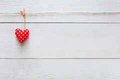 Valentine day love background, pillow heart on wood, copy space Stock Image