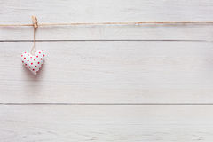 Valentine day love background, pillow heart on wood, copy space Stock Images