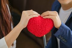 Valentine Day man gave the red heart to girl to show love. Valentine`s Day man gave the red heart to girl to show love royalty free stock photos