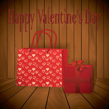 Valentine day Realistic red shopping bag with present on wooden background Royalty Free Stock Photo