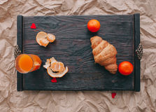 Valentine day.romantic breakfast. Fruits ,coffee and cookies on shate board Stock Photo