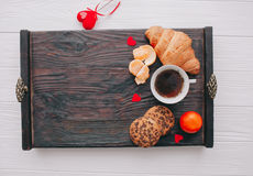 Valentine day.romantic breakfast. Fruits ,coffee and cookies on shate board Royalty Free Stock Photos