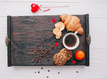 Valentine day.romantic breakfast. Fruits ,coffee and cookies on shate board Royalty Free Stock Photo