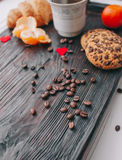 Valentine day.romantic breakfast. Fruits ,coffee and cookies on shate board Stock Photography