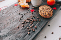 Valentine day.romantic breakfast. Fruits ,coffee and cookies on shate board Stock Image