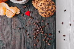 Valentine day.romantic breakfast. Fruits ,coffee and cookies on shate board Stock Photos