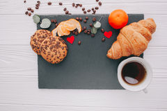Valentine day.romantic breakfast. Fruits ,coffee and cookies on shate board Royalty Free Stock Images