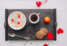 Valentine day.romantic breakfast.oatmeal. With fruit and cookies for shale board Royalty Free Stock Images