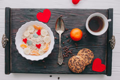 Valentine day.romantic breakfast.oatmeal. With fruit and cookies for shale board Stock Photo