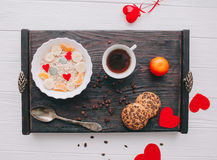 Valentine day.romantic breakfast.oatmeal. With fruit and cookies for shale board Stock Image