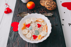 Valentine day.romantic breakfast.oatmeal. With fruit and cookies for shale board Stock Images
