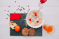 Valentine day.romantic breakfast.oatmeal. With fruit and cookies for shale board Stock Photos