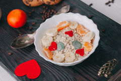 Valentine day.romantic breakfast.oatmeal. With fruit and cookies for shale board Royalty Free Stock Photos