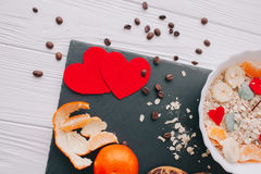 Valentine day.romantic breakfast.oatmeal. With fruit and cookies for shale board Royalty Free Stock Photography