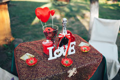 Valentine day romantic dinner. Valentine day decor.love story. decorated table ,hearts , romantic dinner outdoors Stock Photos