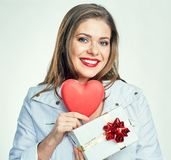 Valentine day style portrait of smiling girl holding heart with. Gift box. isolated portrait Royalty Free Stock Images