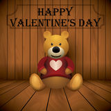 Valentine day Teddy bear brown stuffed toy print on chest wooden background.  Stock Photo