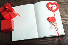Valentine Day. two gift in red box and two hearts on note congratulations. wood Stock Image