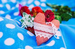 Valentine Day vintage rustic background. Red rag toy heart Stock Photography