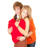 Valentine day young couple with red heart Stock Image