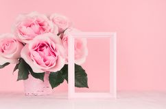 Valentine days background - elegant pastel pink roses bouquet, decorative frame for text on white wood board, copy space. Valentine days background - elegant stock photography