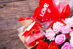 Valentine decoration, chocolate box, roses, heart and love word Stock Photos