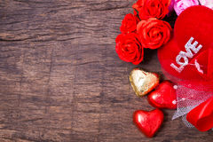 Valentine decoration, heart shaped chocolate, roses, heart  Royalty Free Stock Photography