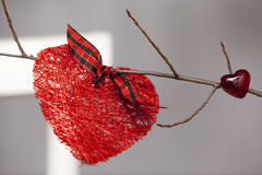 Valentine decorations. Red hearts on the branch Royalty Free Stock Photos