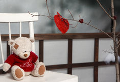 Valentine decorations. Teddy bear with red knitted Royalty Free Stock Images