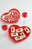 Valentine dessert for two. Valentine dessert. Two glasses of red beverage and cakes with cherries Stock Image