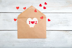 Valentine. envelope kraft paper and red hearts on a wooden backg Royalty Free Stock Photography