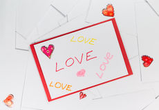 Valentine envelopes with LOVE words on it.  Stock Photos