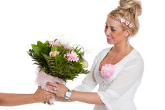 Valentine flowers. Beautiful young woman receiving a bunch of pink flowers Stock Photo