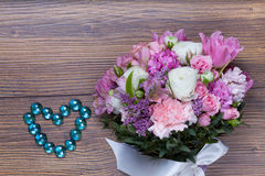 Valentine flowers on with heartshaped jewellery Royalty Free Stock Image