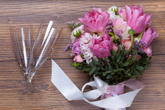 Valentine flowers with wineglass on wooden background Royalty Free Stock Photo