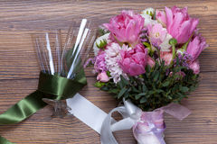 Valentine flowers with wineglasses on wooden background Stock Image