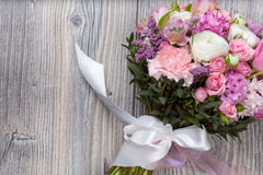 Valentine flowers on wooden background Stock Photo