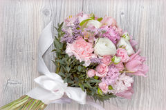 Valentine flowers on wooden background Royalty Free Stock Image