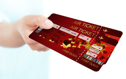 Valentine fly tickets holded by hand Stock Photos