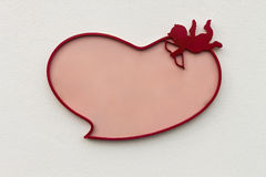 Valentine frame in shape of heart with Cupid Stock Photo