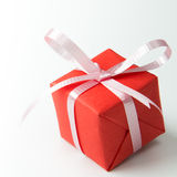 Valentine gift. Red gift box with pink color ribbon isolated on white background Stock Images