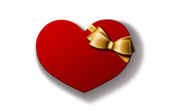 Valentine gift. Heart-shaped red gift box with golden bow  on white background. A Valentine's Day gift / wedding gift Royalty Free Stock Photos