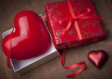 Valentine Gift. Beautiful Valentine Gift over wooden background Royalty Free Stock Images