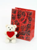 Valentine gift bag and teddy bear. On white Royalty Free Stock Photo