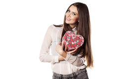 Valentine gift. Beautiful young woman posing with a heart shape gift royalty free stock image