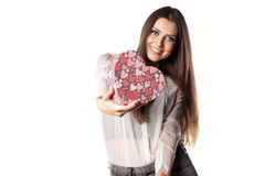 Valentine gift. Beautiful young woman posing with a heart shape gift stock photo