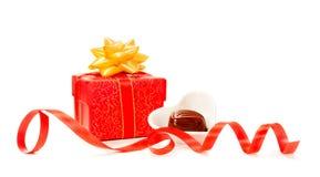Valentine gift box and chocolate. Valentine gift box, ribbon and chocolate candy on white background Stock Photo