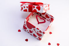 Valentine gift box. Gift box filled with a red heart Royalty Free Stock Photos